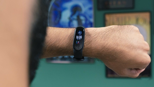 The Xiaomi Mi Smart Band 5 around the wrist