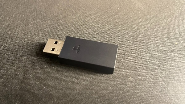 The dongle to connect the Pulse 3D headset to the PS5